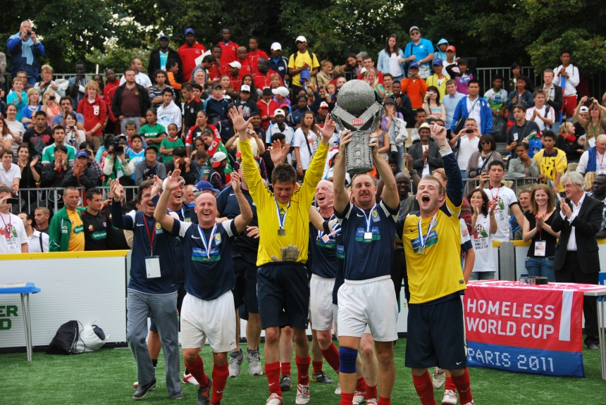 Team Scotland celebrate after winning the final of the Homeless World Cup in Paris, 28 August 2011.