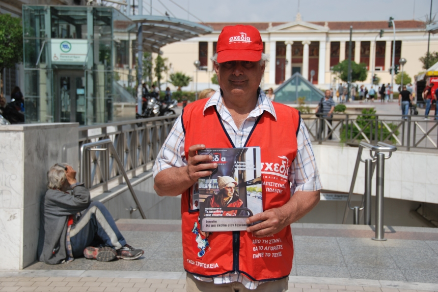 Shedia vendor Nikos selling the magazine at an Athens metro station.